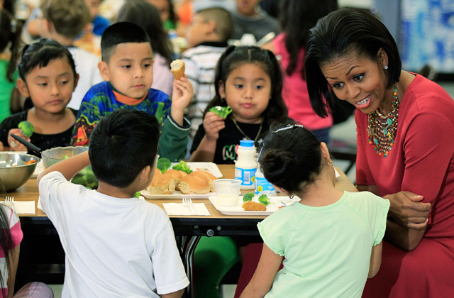 First Lady Michelle Obama talks to Head Start students during lunch as she visits New Hampshire Estates Elementary School on May 19, 2010 in Silver Spring, Maryland. Photo: Alex Wong/Getty Images