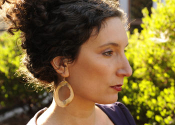 Haven in her family's earrings. Photo by Brittany Powell.