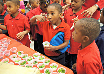 Students at Washington, D.C.'s J.C. Nalle Elementary School sample three different kinds of spinach.  Photo courtesy of D.C. Central Kitchen/USDA.