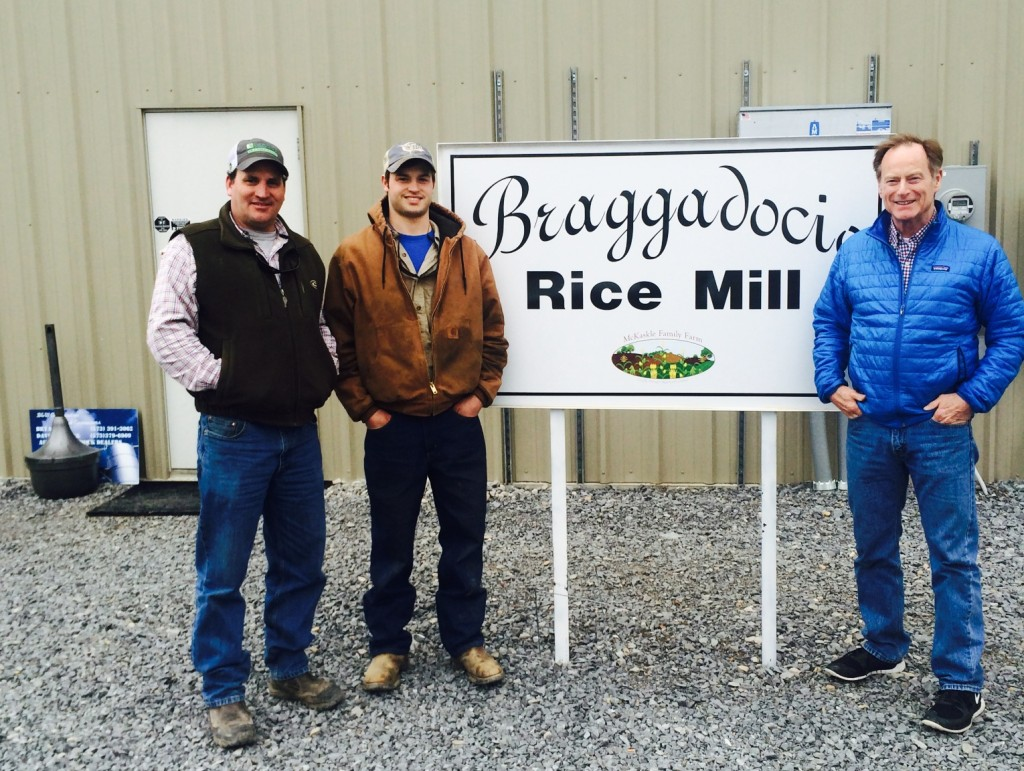 Steve and employees in front of mill