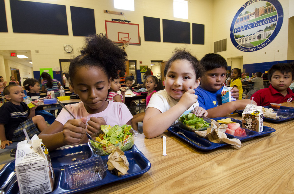 Students eating lunches created to meet the new standards at the Yorkshire Elementary School in Manassas, VA. Photo by Lance Cheung, courtesy of USDA.