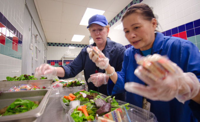 Food Service Manager Hoa Tran and Registered Dietitian Sandra B. O'Connor prepare trays of salad at Nottingham Elementary School in Arlington, VA. Photo by Lance Cheung, courtesy of USDA.