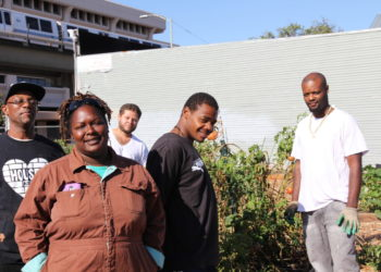 Kelly with the farm's employees.
