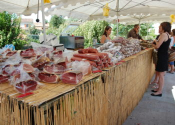 selling meat at a farmers market