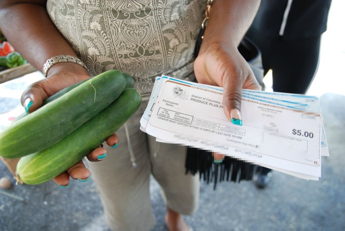 Woman with Fresh Produce and Farmers Market Vouchers