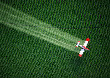 Biplane Spraying Chemical Herbicide Atrazine