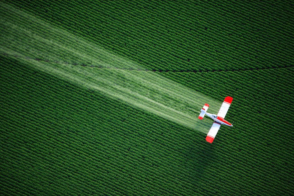 Biplane Spraying Chemical Herbicide Atrazine