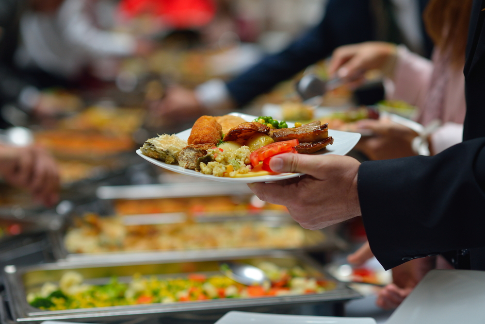 People Serving Food at a Buffet