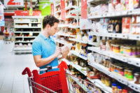 Man Reading FDA Label PFCs at Grocery Store