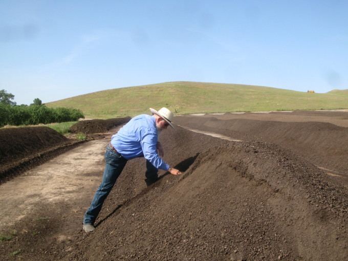 Ward Burroughs with Compost on Organic Almond Farm