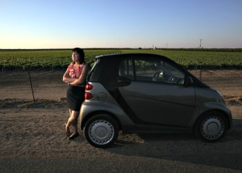 Immigration Lawyer Melanie Gleason with her Smartcar