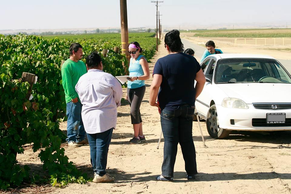Immigration Lawyer Melanie Gleason Speaking with Farmworkers