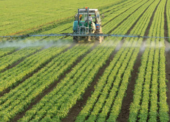 Farm Tractor Spraying Chemicals