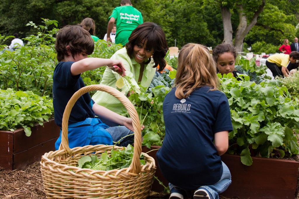 Michelle Obama with Children in Vegetable Garden