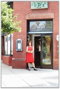Nora Pouillon in front of Restaurant