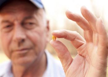 farmer holding a corn seed