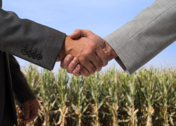 shaking hands farm