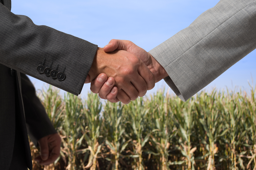 shaking hands farm