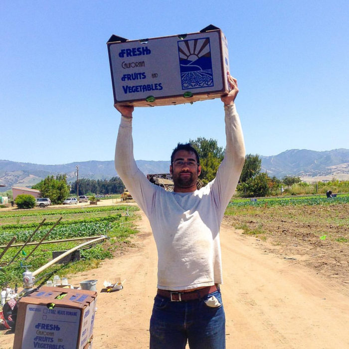 Matthew Loisel hoists some harvested produce.