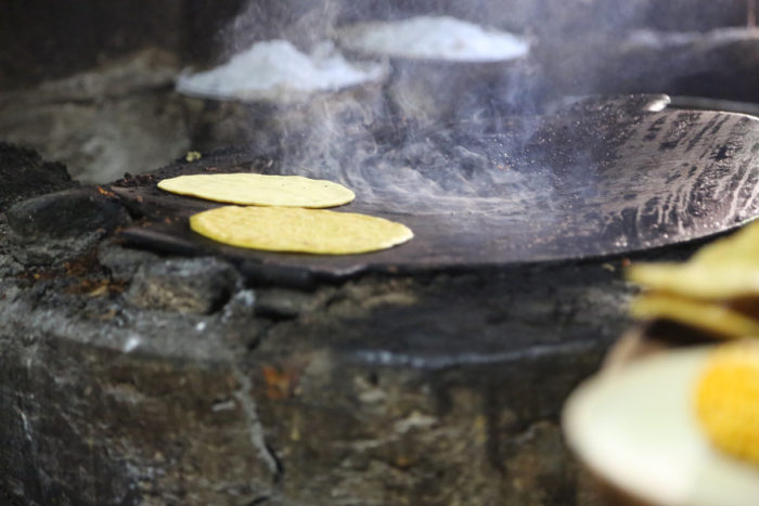 Antonia Chulim Noh's handmade tortillas on her comal in Kahua, Yucatán. (Photo credit: Venetia Thompson)