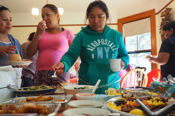 Bertha Leyva (right) and Rocina Lizarraga at the Cooking for Salud! Filipino feast.