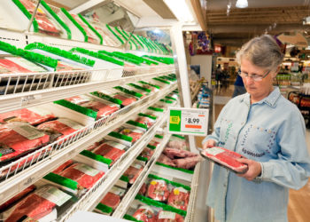 shopper looking at meat prices