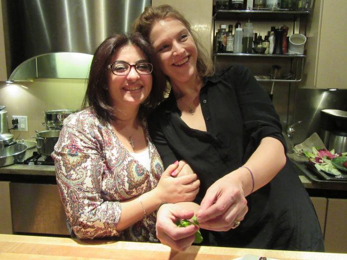 Rana Hashishow (left) and Hannah Goldberg during the Syrian Christmas feast.