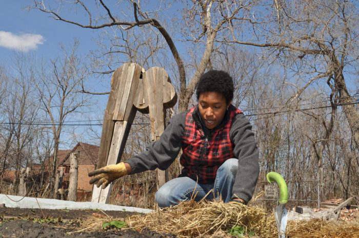 "Olivia Hubert works on Brother Nature Produce, a small farm in Detroit. When she and her partner weren't able to buy the urban lot they were working, they decided to purchase land in the country because, ""We could not take the risk of being put off our land like some other growers had been."" Photo by Michigan Municipal League, April 2011."