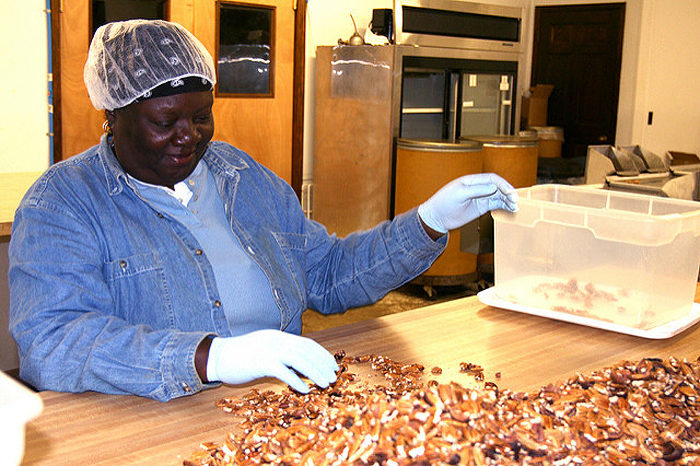 A member of the Southern Alternatives Agricultural Cooperative, a women-run, fair trade pecan-processing operation in southwest Georgia. Photo by the Unitarian Universalist Service Committee, December 2009.
