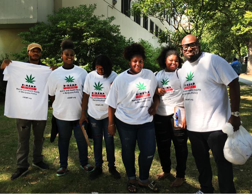 Malaki Seku-Amen (far right) with volunteers collecting petition signatures at the Imagine Justice concert in Sacramento in 2017. (Courtesy Malaki Seku-Amen)