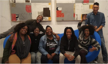 Sam Love (back left) and fellow staff and the founders of The Hood Incubator.