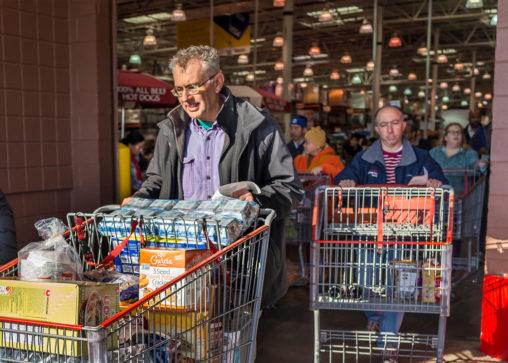 people leaving a supermarket