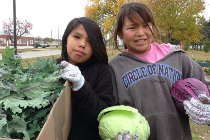 Students at Circle of Nations School in Wahpeton, ND gather vegetables that they grew in the school's garden. (Photo courtesy of the USDA)