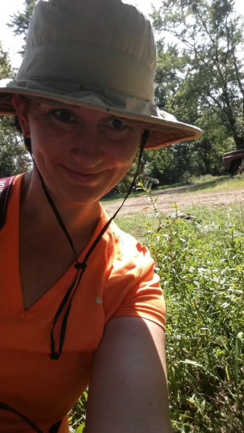 Archaeo-botanist Natalie Mueller with the first clump of wild erect knotweed she ever found. (Photo credit: Natalie Mueller)