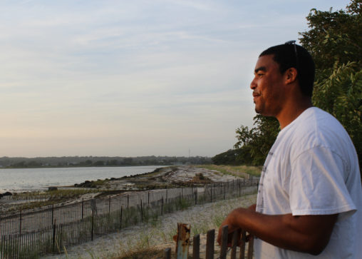 Shinnecock tribe member Shane Weeks looks out over the tribe's territorial waters. (Photo by Alexandra Talty)