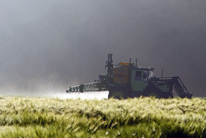 Farm tractory spraying crops. (Photo credit: hpgruesen)