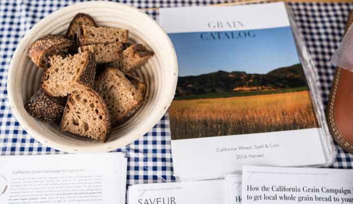 The California Grain Campaign catalogue with Mai Nguyen's grains in bread. (Photo by Jessica Blackstock)