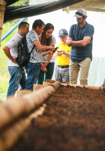 Daniela Uribe and Drew Fink visiting coffee farmers to discuss sourcing cascara. (Photo courtesy of Lazy Bear Tea)