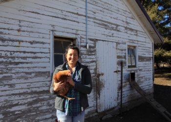 Wendy Johnson holding a chicken