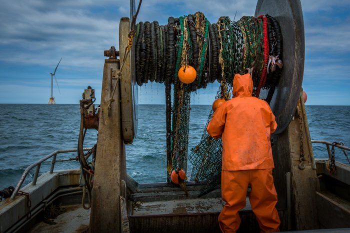 Dean West helps recover the F/V Proud Mary's net after a tow near the Block Island Wind farm. Photo © Ayla Fox for The Nature Conservancy