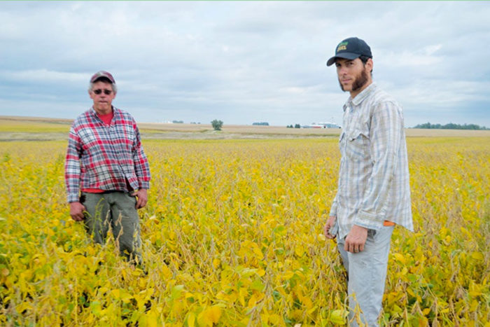 Levi Lyle (right) transitioned his family's farm to organic after his father Trent (right) overcame cancer. Photo by Bill Tiedje