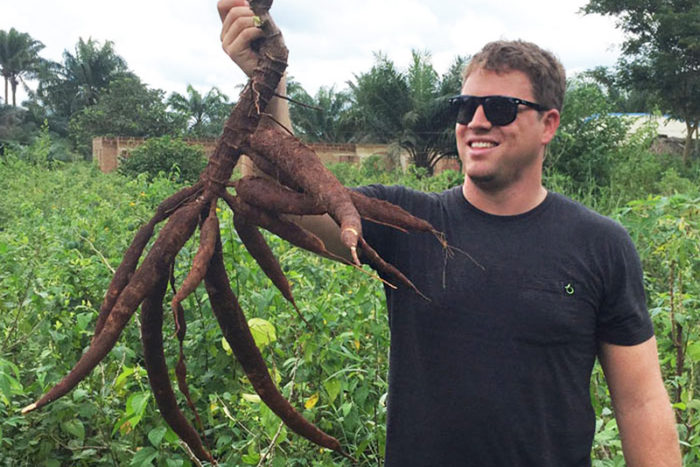 apeel founder holding a cassava root