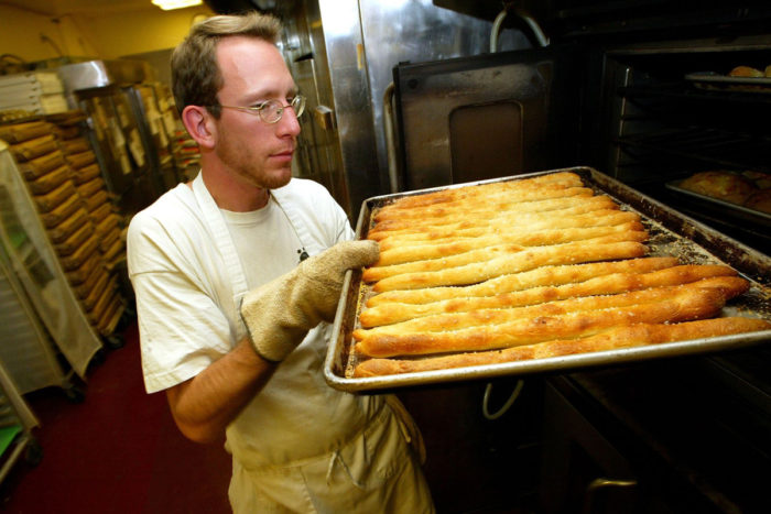 An employee at Arizmendi Bakery in 2003. The co-op now has six affiliate bakeries throughout the Bay Area. (Photo credit: Justin Sullivan/Getty Images)