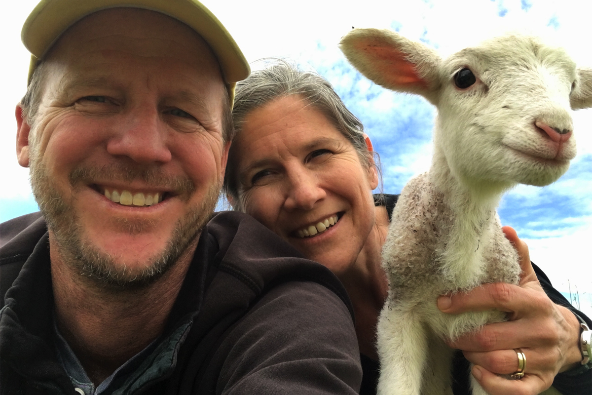 Greg Massa, Raquel Krach, and a newborn lamb.
