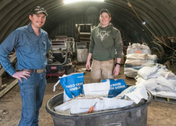 Dallas Glazik (right) and brother Will Glazik with some of the corn varieties they grow on their farm near Paxton, IL on Friday, April 13, 2018. (Photo by Darrell Hoemann/The Midwest Center for Investigative Reporting)