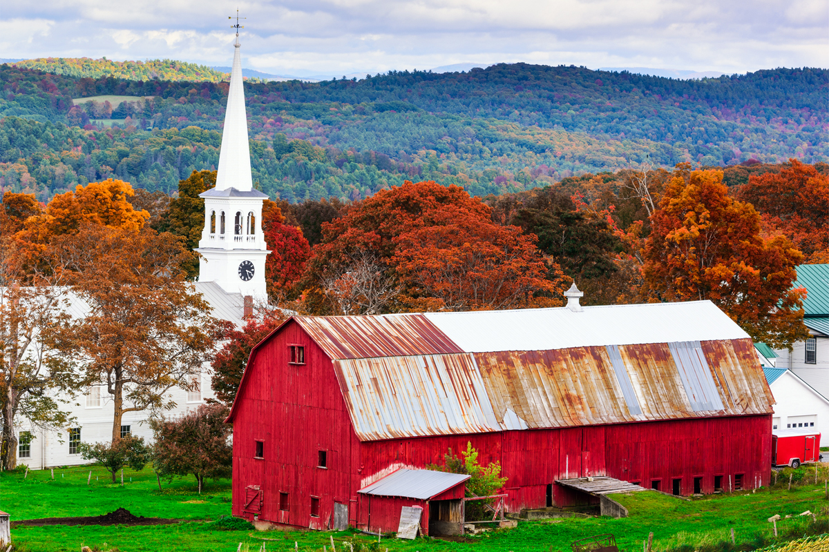 A rural farm and church in Vermont. (Photo credit: Sean Pavone / iStock)