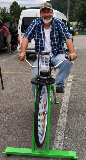 Woody Hartlove on the Harlan County Farmers' Market's Blender Bike. (Photo courtesy Renew Appalachia)