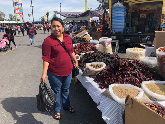 Rosa Hernandez at the swap meet in Madera, where local residents can buy many products used in Oaxacan cooking. (Photo credit: Lisa Morehouse)