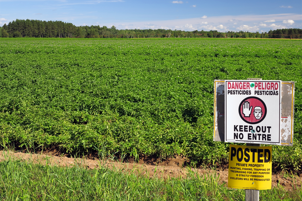 Sign warning about pesticides on a farm