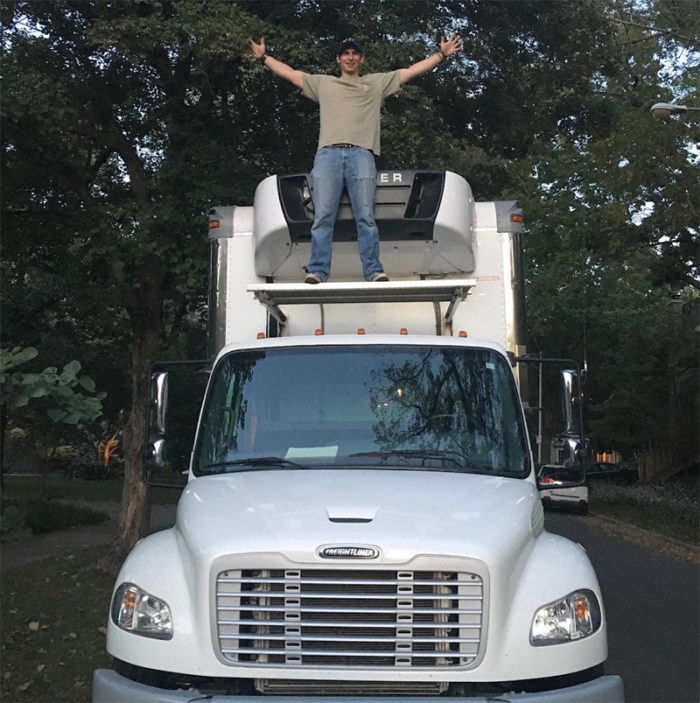 Kaniger with his delivery truck / warehouse. (Photo courtesy of Kanbe's Market)